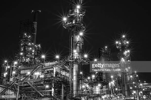 Low Angle View Of Illuminated Industry At Night