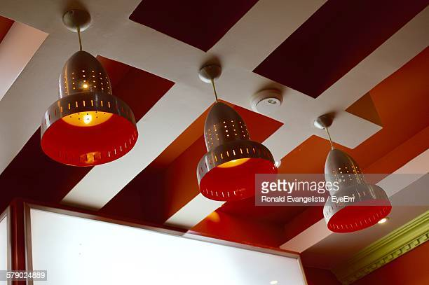 Low Angle View Of Illuminated Lamps At Home