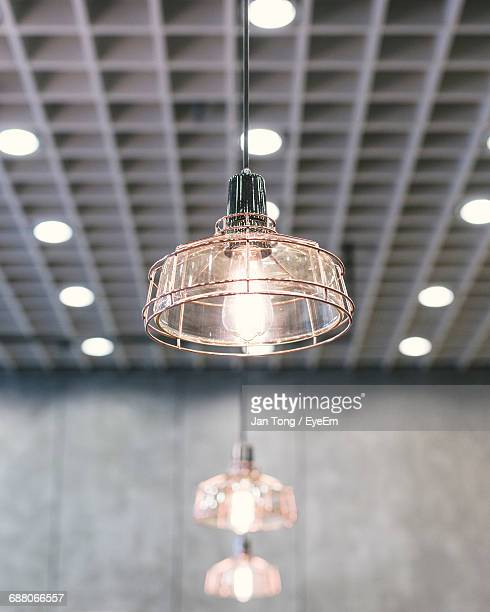Low Angle View Of Illuminated Lamps In Room