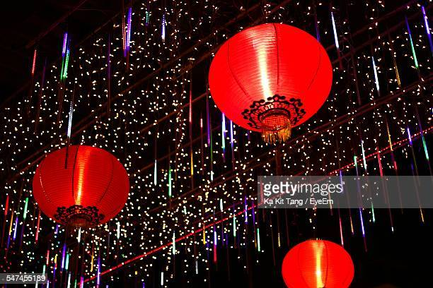 Low Angle View Of Illuminated Lanterns And Decoration At Night