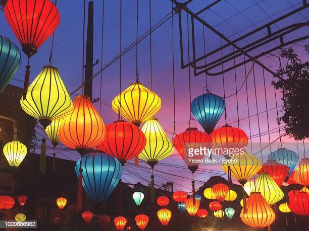 Low Angle View Of Illuminated Lanterns Hanging Against Sky
