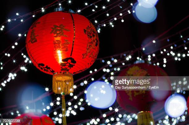 low angle view of illuminated lanterns hanging against sky - chinese dragon stock photos and pictures