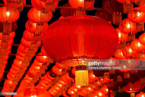 low angle view of illuminated lanterns hanging at night - 中国提灯 ストックフォトと画像