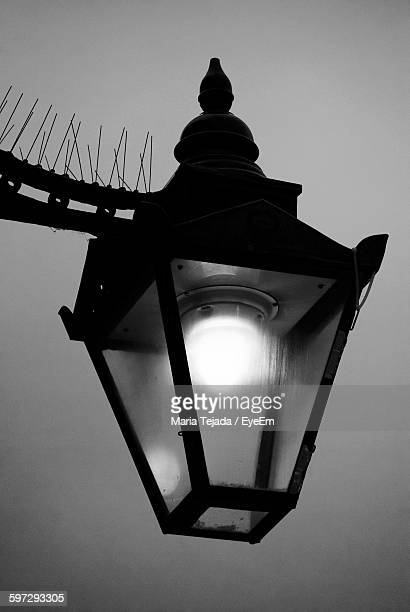 low angle view of illuminated light against sky - maria tejada stock pictures, royalty-free photos & images