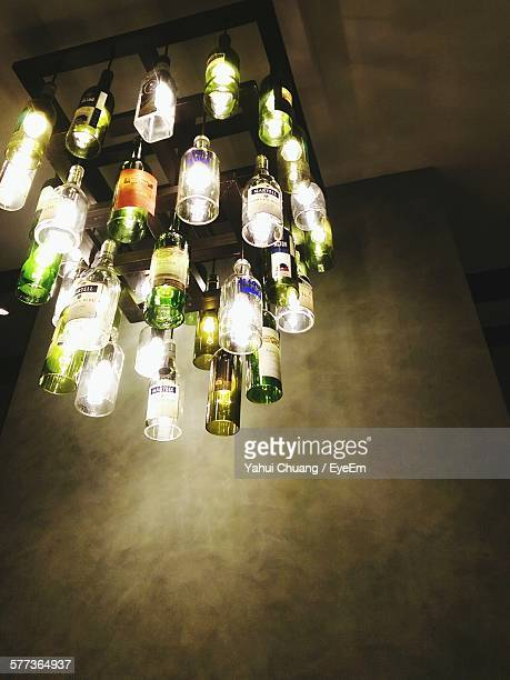 Low Angle View Of Illuminated Light Fixture Hanging From Ceiling