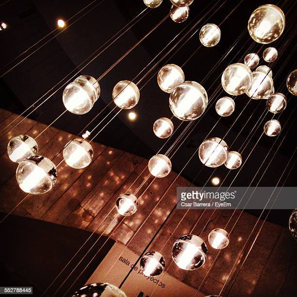 Low Angle View Of Illuminated Light Fixture