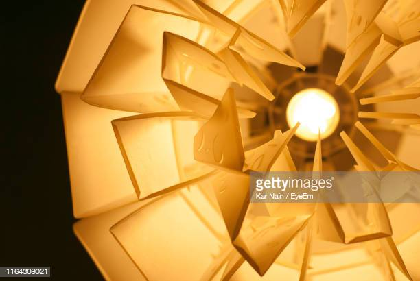low angle view of illuminated lighting equipment - west kalimantan stock pictures, royalty-free photos & images