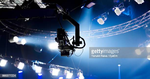 low angle view of illuminated lighting equipment - bts stock pictures, royalty-free photos & images