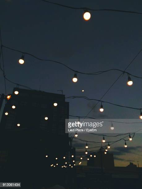 Low Angle View Of Illuminated Lights Against Sky At Night