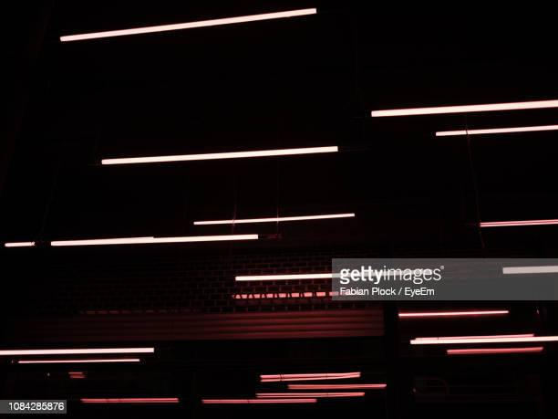 low angle view of illuminated lights at night - fluorescent light stock pictures, royalty-free photos & images