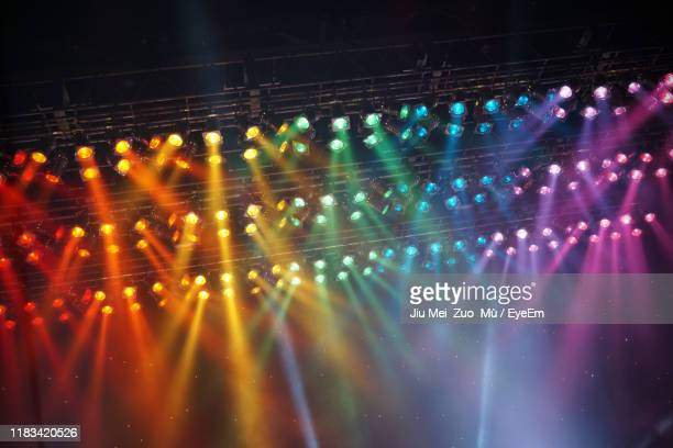low angle view of illuminated lights at night - popular music concert stock pictures, royalty-free photos & images