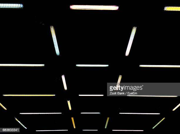 Low Angle View Of Illuminated Lights On Ceiling In Darkroom