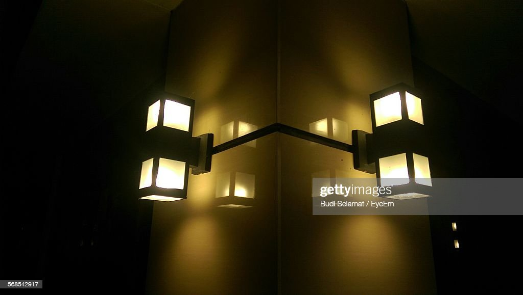 Low Angle View Of Illuminated Lights On Wall : Stock Photo