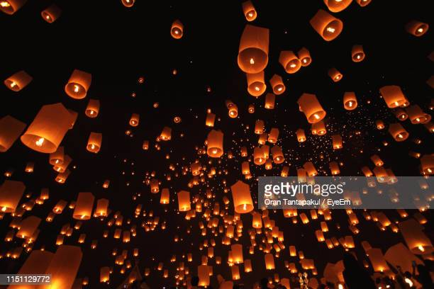 low angle view of illuminated paper lanterns at night - 中国提灯 ストックフォトと画像