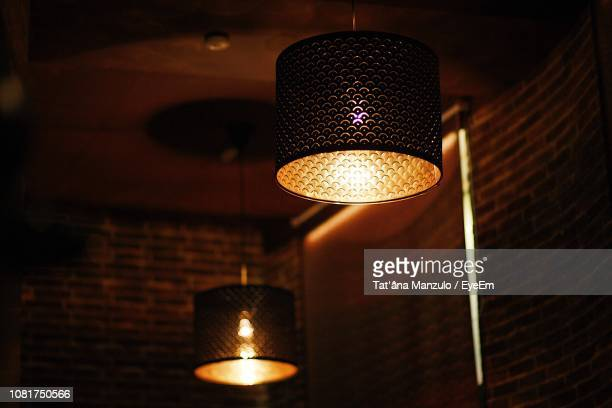 low angle view of illuminated pendant light - ceiling stock pictures, royalty-free photos & images