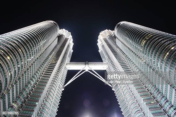 Low Angle View Of Illuminated Petronas Tower Against Sky