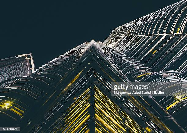 Low Angle View Of Illuminated Petronas Towers Against Sky At Night