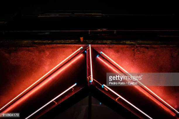 Low Angle View Of Illuminated Red Railing
