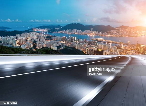 low angle view of illuminated road at night, australia - image stock pictures, royalty-free photos & images