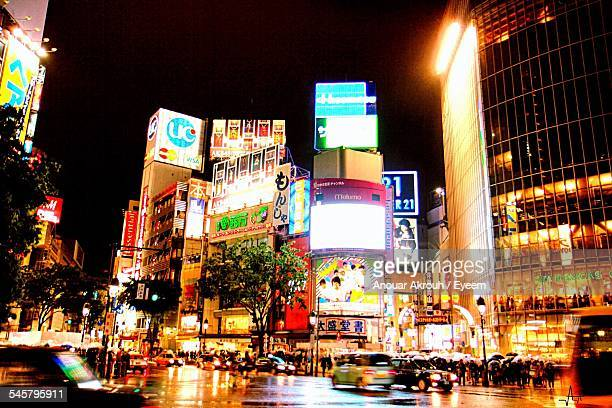 Low Angle View Of Illuminated Shibuya Station At Night In City