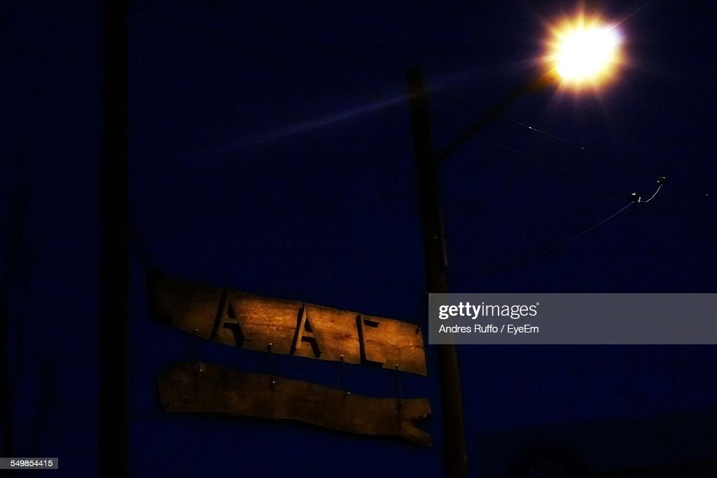 Low Angle View Of Illuminated Signboard Against Sky At Night : Stock Photo