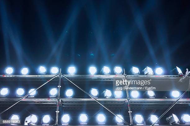 Low Angle View Of Illuminated Spotlights At Event