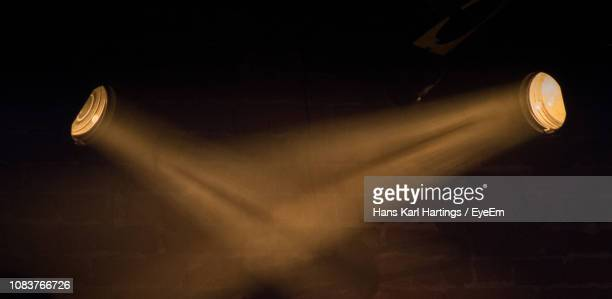 low angle view of illuminated spotlights - spotlit stock pictures, royalty-free photos & images