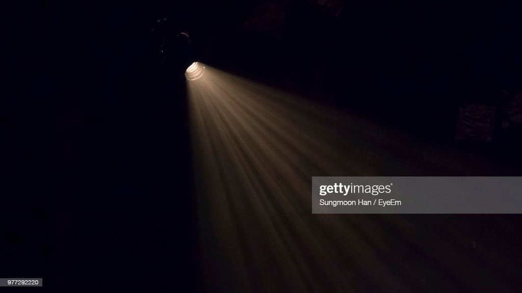Low Angle View Of Illuminated Stage Light In Darkroom : Stock Photo