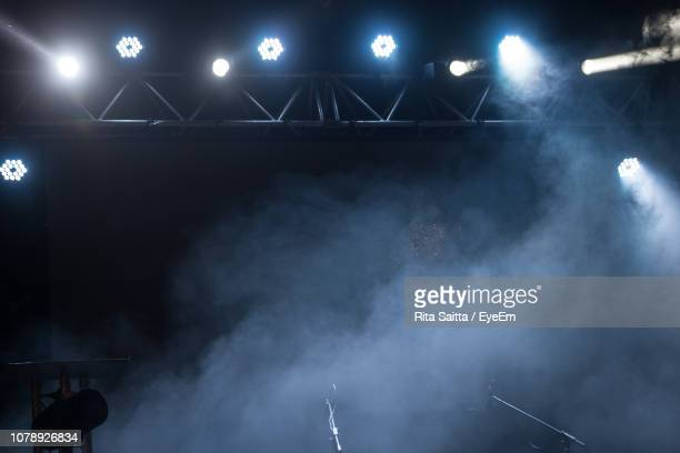 low angle view of illuminated stage lights at night - stage light stock pictures, royalty-free photos & images