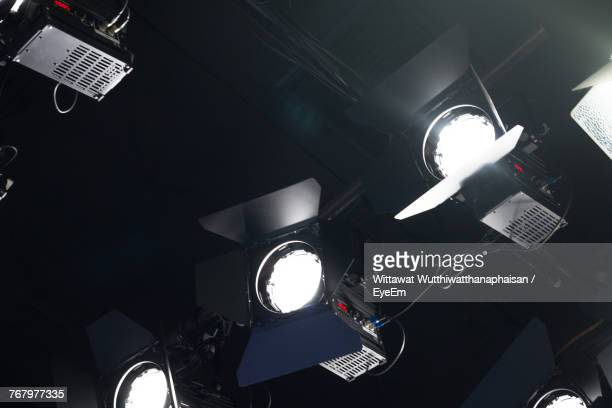 Low Angle View Of Illuminated Stage Lights