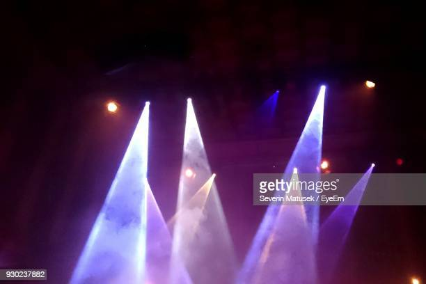 low angle view of illuminated stage lights - stage light stock pictures, royalty-free photos & images