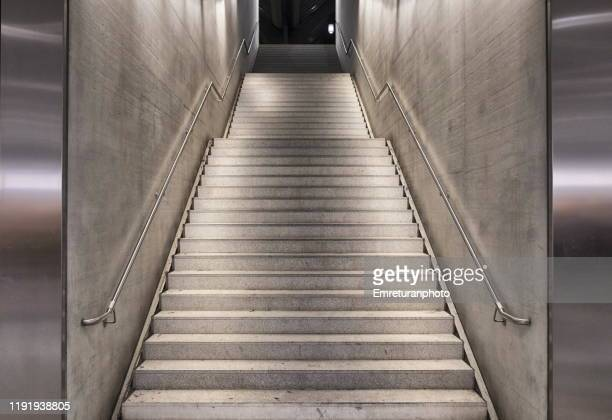 low angle view of illuminated staircase to street level,zuirch. - emreturanphoto stock pictures, royalty-free photos & images