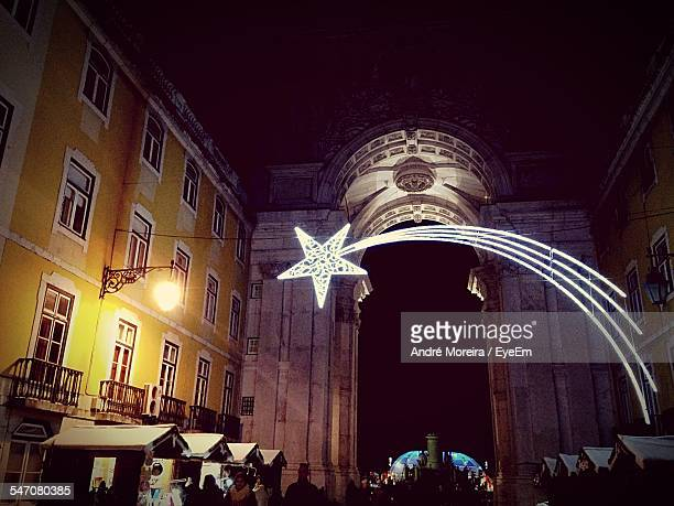 low angle view of illuminated star at rua augusta arch - rua stock pictures, royalty-free photos & images