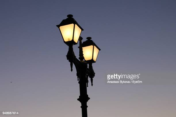 low angle view of illuminated street light against clear sky - anastasi foto e immagini stock