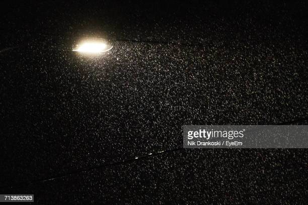 Low Angle View Of Illuminated Street Light At Night During Monsoon