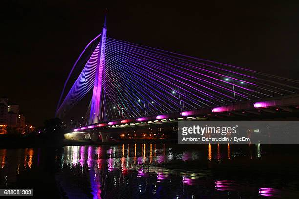 low angle view of illuminated suspension bridge at night - putrajaya stock pictures, royalty-free photos & images