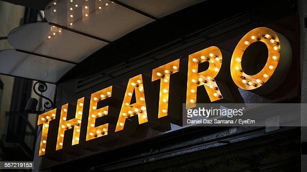 Low Angle View Of Illuminated Text On Theater