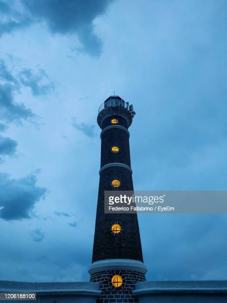 low angle view of illuminated tower against sky - jose ignacio lighthouse stock pictures, royalty-free photos & images