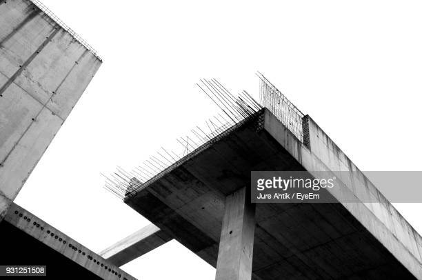 low angle view of incomplete bridge against clear sky - incomplete stock pictures, royalty-free photos & images
