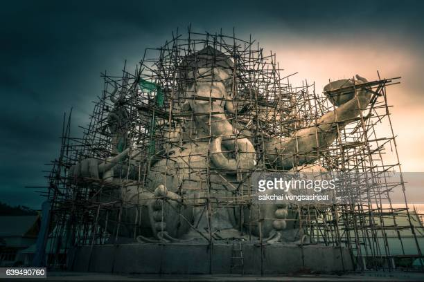 Low Angle View Of Incomplete Ganesha Statue Against Sky During Sunrise