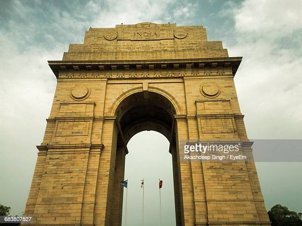 low angle view of india gate against sky - india gate stock pictures, royalty-free photos & images