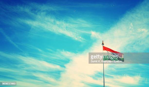 low angle view of indian flag against blue sky - indian flag stock pictures, royalty-free photos & images