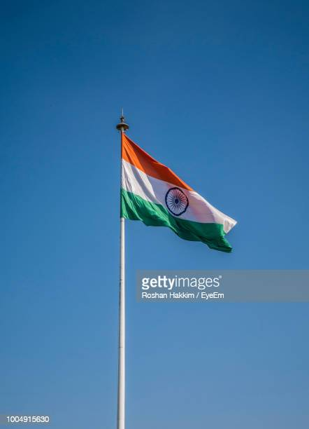 low angle view of indian flag against clear blue sky - indian flag stock pictures, royalty-free photos & images