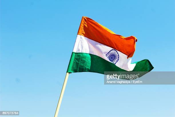 low angle view of indian flag against clear blue sky - india flag stock photos and pictures