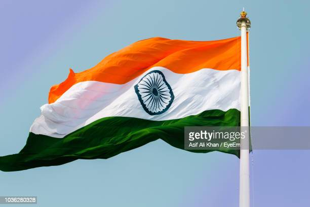 low angle view of indian flag against clear sky - indian flag stock pictures, royalty-free photos & images