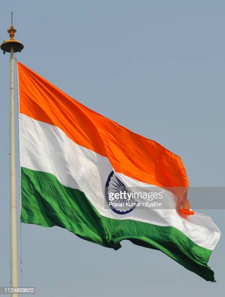 low angle view of indian flag against sky - indian flag stock pictures, royalty-free photos & images