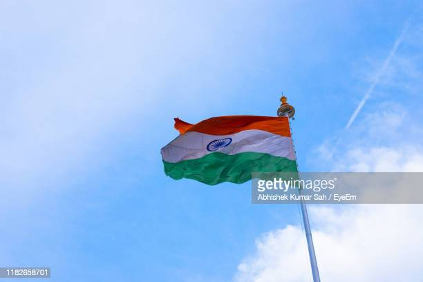 low angle view of indian flag on pole against sky - republic day stock pictures, royalty-free photos & images