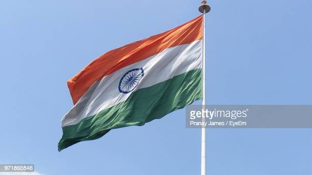 low angle view of indian flag waving against clear sky - india flag stock photos and pictures