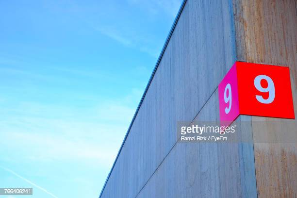 low angle view of information sign against blue sky - number 9 stock pictures, royalty-free photos & images
