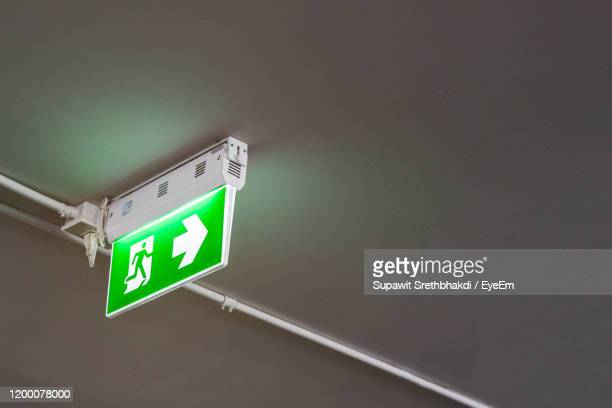 low angle view of information sign on ceiling - escaping stock pictures, royalty-free photos & images